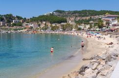 Mallorca beach in summer. Mallorca, Spain - June 26, 2017: People enjoy the beach on a warm summer`s day in Port De Soller Stock Image