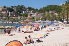 Mallorca beach in summer. Mallorca, Spain - June 26, 2017: People relaxing on the beach on a warm summer`s day in Port De Soller Stock Photo