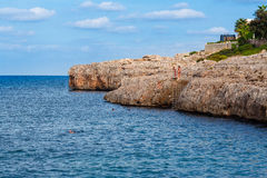 Mallorca Cliffs Jumping. Mallorca Cliffs People Diving in the sea Royalty Free Stock Image