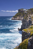Mallorca cliffs with surf. And views of white houses Royalty Free Stock Photos