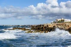 Mallorca coast. Sea waves and rocks. Mallorca landscape. Rocky shore and breaking waves Stock Photos