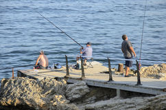 Mallorca fishermen. Fishermen enjoying peace of sea fishing Stock Images