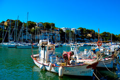 Mallorca habour scenery. MALLORCA - AUGUST 01: row of boats moored in port of old town of Soller on August 01, 2015, Balearic Island, Spain Royalty Free Stock Photo