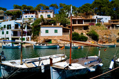 Mallorca habour scenery. MALLORCA - AUGUST 01: row of boats moored in port of old town of Soller on August 01, 2015, Balearic Island, Spain Royalty Free Stock Images