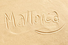 Mallorca handwritten in golden beach sand. Conceptual of seaside tropical summer destinations around the Mediterranean, travel and tourism Stock Photos