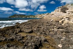 Stony Coast  of Mallorca. Mallorca has Rough Stones at the mediterranen Beach , it is an Island of the Baleares. .blue sky and light CloudKit make an Perfect das Stock Images