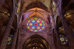 Palma, Mallorca, Majorca, Balearic Islands, Spain, La Seu, cathedral, church, decoration, Saint Mary, rose window, interior. The arches and the rose window Royalty Free Stock Photo