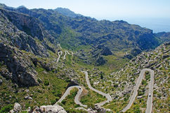 Mallorca, Majorca, Balearic Islands, Spain. Panoramic view along the winding road leading in Cala Tuent on June 11, 2012. Cala Tuent is a remote beach at the Royalty Free Stock Images