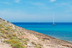 Mallorca, Majorca, Balearic Islands, Spain, Mediterranean Sea, cove, bay, nature, landscape, secret place, desert, beach, sailboat. A sailboat and the Stock Images