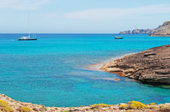 Mallorca, Majorca, Balearic Islands, Spain, Mediterranean Sea, cove, bay, nature, landscape, secret place, desert, beach, sailboat. A sailboat, a speedboat and Stock Image