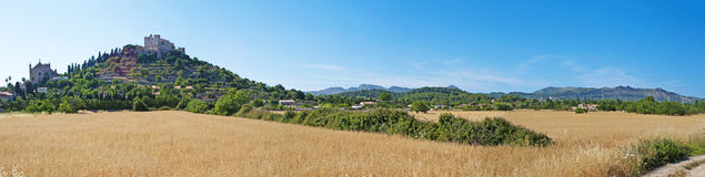 Mallorca, Majorca, Balearic Islands, Spain, Arta, countryside, wheat field, nature, landscape, perched. The small town of Arta seen trough a wheat field on June Stock Photos