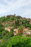 Valldemossa, perched, Mallorca, Majorca, Balearic Islands, Spain, citadel, old town, skyline, architecture, stone, nature, green. A view of the rural town of Royalty Free Stock Image
