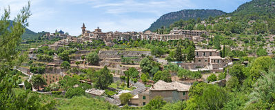 Valldemossa, perched, Mallorca, Majorca, Balearic Islands, Spain, citadel, old town, skyline, architecture, stone, nature, green. A view of the rural town of Stock Image