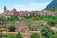 Valldemossa, perched, Mallorca, Majorca, Balearic Islands, Spain, citadel, old town, skyline, architecture, stone, nature, green. A view of the rural town of Royalty Free Stock Photo