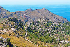 Mallorca, Majorca, Balearic Islands, Spain, Mediterranean Sea, cove, bay, nature, landscape, secret place, desert, winding road. The winding road leading in Cala Stock Photography