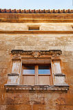 Mallorca, Majorca, Balearic Islands, Spain. A window on an ancient building in Alcudia, June 10, 2012. Alcudia is one of the main tourist centers of the island Royalty Free Stock Photos