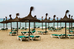 Mallorca (Majorca) beach. Beach in Mallorca (Majorca),Balearic Island with umbrellas and Beach chairs Royalty Free Stock Photos