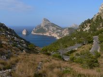 Mallorca sea view. Sea view from mountain-side in Mallorca, Spain. Hair-pin bend in the road royalty free stock image