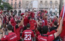 Mallorca soccer fans celebrate after promoting to higher division. Mallorca soccer team supporters celebrate on a fountain downtown palma after their team Real Royalty Free Stock Photos