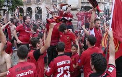 Mallorca soccer fans celebrate after promoting to higher division. Mallorca soccer team supporters celebrate on a fountain downtown palma after their team Real Stock Photos