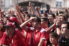 Mallorca soccer fans during promotion game on giant screen detail. Mallorca soccer team supporters gesture while watching their promotion to higher division Stock Image