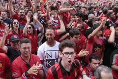 Mallorca soccer fans during promotion game on giant screen. Mallorca soccer team supporters gesture while watching their promotion to higher division match on a Royalty Free Stock Photography