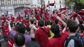 Mallorca soccer fans celebrate after promoting to higher division. Mallorca soccer team supporters celebrate on a fountain downtown palma after their team Real Royalty Free Stock Image