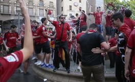 Mallorca soccer fans celebrate after promoting to higher division. Mallorca soccer team supporters celebrate on a fountain downtown palma after their team Real Stock Images