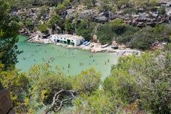 Cala Pi beach. MALLORCA, SPAIN - AUGUST 7, 2018: Cala Pi beach with tourists on a sunny summer day on August 7, 2018 in Mallorca, Spain royalty free stock photo