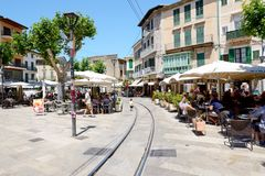 The tram rails are on street of Soller town and tourists. MALLORCA, SPAIN - JUNE 2: The tram rails are on street of Soller town and tourists are in outdoor Royalty Free Stock Photography