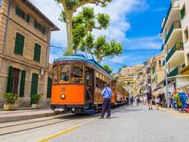 Port Soller of Mallorca island. Mallorca, Spain - May 20, 2018: Traditional tramway and tourists in Port Soller of Mallorca Royalty Free Stock Image
