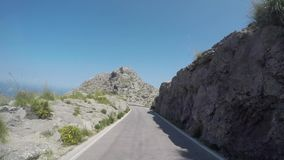 Mallorca, Spain. Time lapse of the panoramic and tourist road leading to the port of Sa Calobra. The famous tie knot road. Winding and narrow road. Summer time stock video