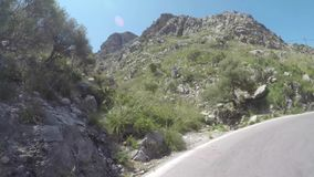 Mallorca, Spain. Time lapse of the panoramic and tourist road leading to the port of Sa Calobra. Winding and narrow road. Summer time stock video footage