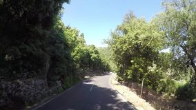 Mallorca, Spain. Time lapse of the panoramic and tourist road leading to the port of Sa Calobra. Winding and narrow road. Summer time stock video