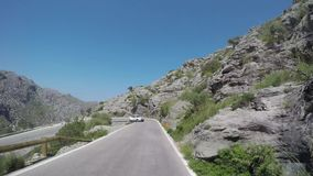 Mallorca, Spain. Time lapse of the panoramic and tourist road leading to the port of Sa Calobra. Winding and narrow road. Summer time stock footage