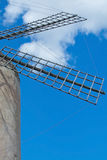 Mallorca windmill sky. Windmill detail on a sunny day with blue sky in Mallorca, Balearic islands, Spain Stock Image