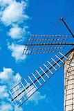 Mallorca windmill sky. Windmill detail on a sunny day with blue sky in Mallorca, Balearic islands, Spain Stock Images
