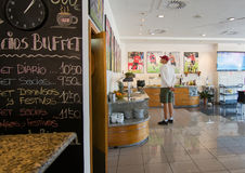Mallorcafe interior. SON MOIX, PALMA DE MALLORCA, SPAIN - JULY 26, 2015: Mallorcafe interior with football player prints and guest of football or soccer stadium Stock Photos