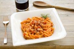 Malloreddus alla campidanese. Typical sardinian pasta seasoning with tomato sauce,sausage and parmesan Stock Photos