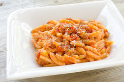 Malloreddus alla campidanese. Typical sardinian pasta with tomato sauce and pork sausage Stock Photography