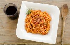 Malloreddus alla campidanese. Typical sardinian pasta with tomato sauce and pork sausage Royalty Free Stock Photos
