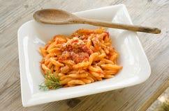 Malloreddus alla campidanese. Typical sardinian pasta with tomato sauce and pork sausage Stock Photos