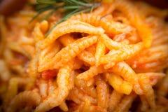 Malloreddus alla Campidanese. Sardinian pasta with pork sausage and tomato sauce, traditional recipe Stock Images