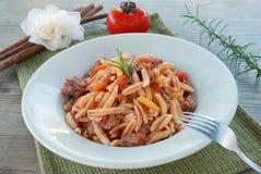 Malloreddus - italian pasta. Typical Sardinian pasta topped with tomato and sausage Stock Photos