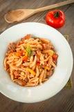 Malloreddus, sardinian cuisine. Dish of sardinian pasta stuffed with tomato and sausage sauce Stock Images