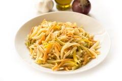 Malloreddus, Sardinian pasta. Dish of traditional sardinian pasta isolated on white Stock Image