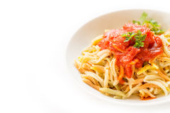 Malloreddus with tomato sauce, Sardinian pasta. Dish of traditional sardinian pasta isolated on white Stock Image