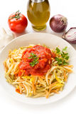 Malloreddus with tomato sauce, Sardinian pasta Stock Images