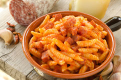 Malloreddus with tomato sauce and sausage. Recipe for traditional pasta from Sardinia, Italy Stock Photography