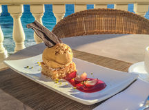 Mallorquin almond cake with icecream and chocolate served in a restaurant Stock Photos